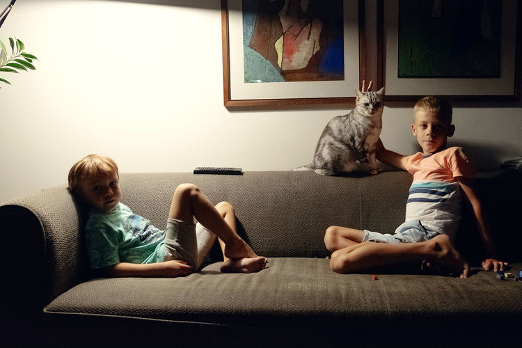 The Week on EyeEm Boys Brother Child Childhood Family Females Full Length Furniture Indoors  Innocence Leisure Activity Lifestyles Living Room Males  Men Offspring Sitting Sofa Togetherness Two People Watching