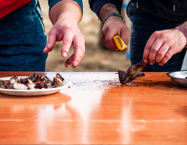 Close-up of man preparing food on table