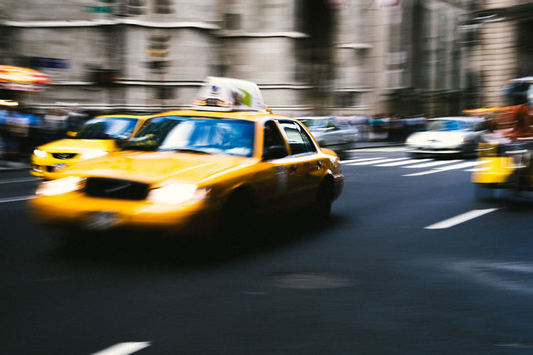 Iconic yellow cabs in New York City is rapidly disappearing due to the emergence of ride-sharing businesses like uber and Lyft. Soon the yellow cabs will be obsolete. Blurred Motion Car City City Life City Street In Motion Let's Go. Together. Low Light Low Light Photography Motion Moving Vehicle New York New York City No People Road Speed Street Taxi Transportation Transportation Urgency Yellow Yellow Cab Yellow Cabs Yellow Taxi Mobility In Mega Cities
