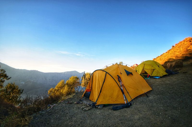 Tents On Mountain Against Blue Sky During Sunset