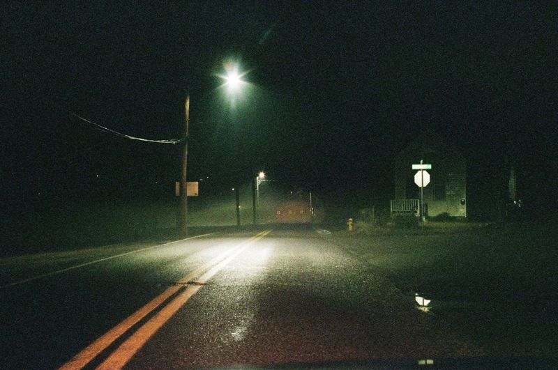 Night Illuminated Street Light Lighting Equipment Transportation Road Outdoors The Way Forward No People Nature Eerie Eerie Scene Spooky Shadow And Light Analogue Photography 35mm