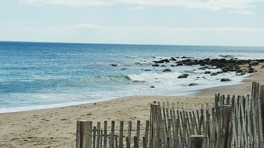 Beach Fence Waves Water Sea Beach Sand Sky Horizon Over Water Wooden Post Coastline Shore Surf Tide Seascape Coast Coastal Feature Ocean Rocky Coastline