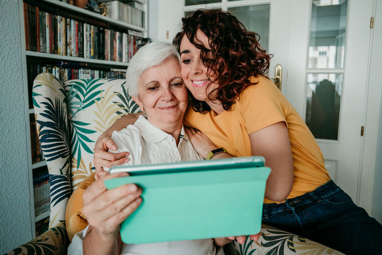 Senior woman and daughter at home