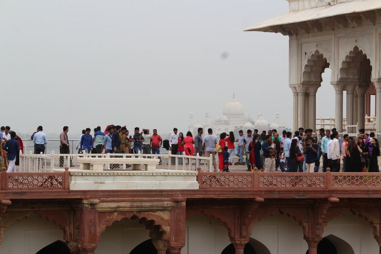 Admirers of the Taj Mahal. Arch Architectural Column Architecture Bridge Bridge - Man Made Structure Building Exterior Built Structure Crowd Day Group Of People History Large Group Of People Men Nature Outdoors Real People Sky The Past Tourism Travel Travel Destinations Water Women