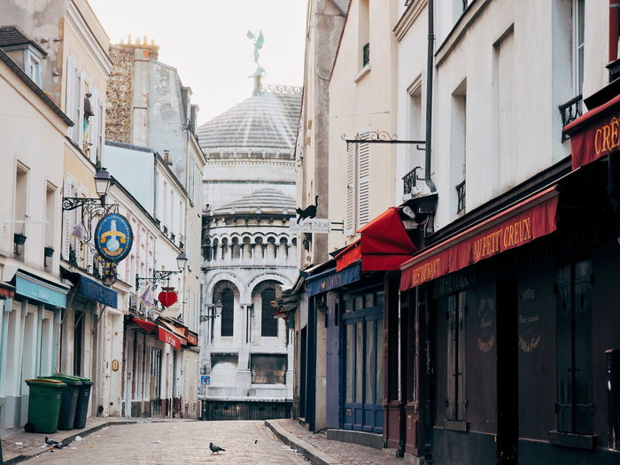 Architecture Built Structure Building Exterior City No People Day Clock Outdoors Cathedral Early Morning Empty Streets Cobblestone Montmartre Paris Architecture Montmartre, Paris Quiet Moments Paris Streets Alleyway