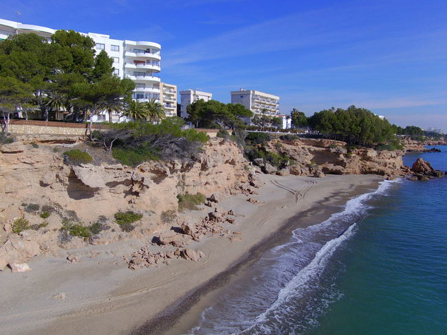 Drone  Miami Platja-Tarragona-Spain Architecture Beach Beauty In Nature Building Exterior Built Structure Clear Sky Day Drone Photography Nature No People Outdoors Rock - Object Sand Scenics Sea Sky Travel Destinations Tree Turistic Places Water Wave