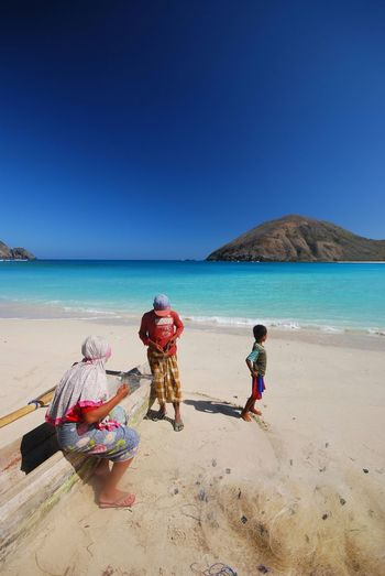 Traditional Fisherman Family at Mawun Beach, Lombok, West Nusa Tenggara fixing the fish net, August 2018 Mawun Beach Lombok Mawun INDONESIA Fisherman Family Net Lombok Lombok-Indonesia Lombok Island Nusa Tenggara Barat West Nusa Tenggara Sea Clear Sky Full Length Water Beach Sand Blue Sunny Sky Horizon Over Water Longtail Boat Turquoise Colored Calm Shore Seascape Sandy Beach My Best Travel Photo A New Beginning