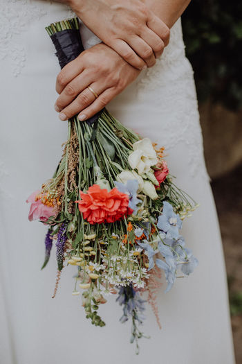 Woman holding wedding bouquet Bohemian Dress Engagement Love Natural Natural Light Nature Wedding Wedding Bouquet Wedding Photography Bouquet Close-up Day Flower Holding Human Body Part Human Hand People Photography Ring Vintage Wedding Day Wedding Photos Wedding Ring Women