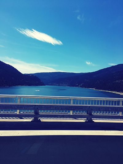 Mountain Railing Road Transportation Mountain Range Bridge - Man Made Structure Sky Outdoors River Day Scenics Blue Water Beauty In Nature No People Nature