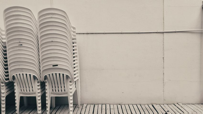 EyeEm Selects Architecture Building Exterior Outdoors Built Structure Day No People Monochromatic Preparedness Preparation  Copy Space Architecture Stacked Chairs Wall The EyeEm Collection End Plastic Pollution