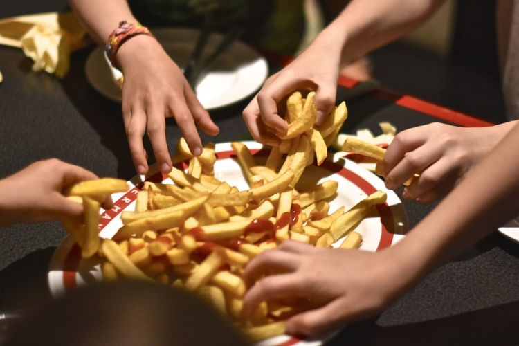 Children Close-up Day Finger Food Food Food And Drink Freshness Friendship Fries Holding Human Body Part Human Hand Incidental People Indoors  Men Midsection Ready-to-eat Real People Snack Togetherness Women