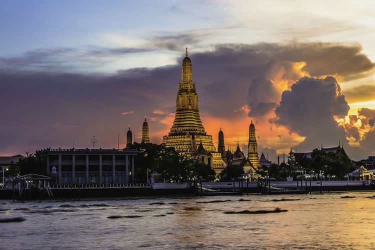 Wat Arun or Wat Arun is a temple on the west bank of the Chao Phraya River, Bangkok, Thailand. Architecture Belief Building Building Exterior Built Structure Cloud - Sky Nature No People Outdoors Place Of Worship Religion Sky Spire  Spirituality Sunset Tourism Travel Travel Destinations Water Waterfront
