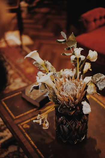 Close-up of wilted flower vase on table