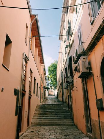 Exploring the unknown. Streetphotography Color EyeEm Selects Building Exterior Architecture Built Structure Building Residential District Direction Narrow City No People Wall - Building Feature Diminishing Perspective Alley Town