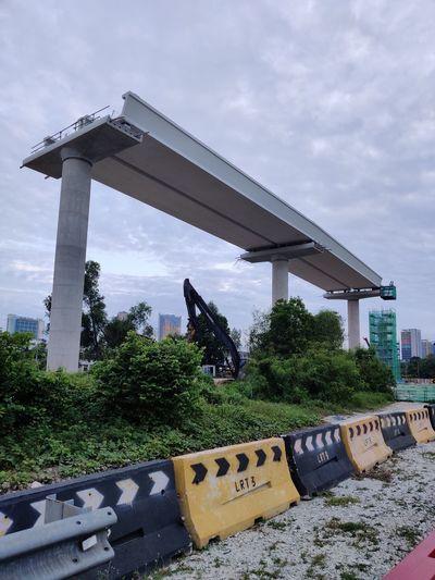 Bridge over city against sky