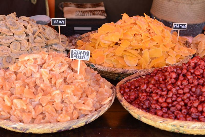 Various dried fruits in plate at market