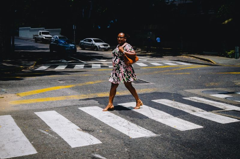 Cruzar con estilo. The Art Of Street Photography Road Marking Crosswalk City Full Length One Person Road Street Marking Transportation Crossing Zebra Crossing Symbol Real People Lifestyles Day Motor Vehicle Casual Clothing Car Sign Outdoors Streetphotography Street Photography EyeEm Best Shots EyeEm Selects