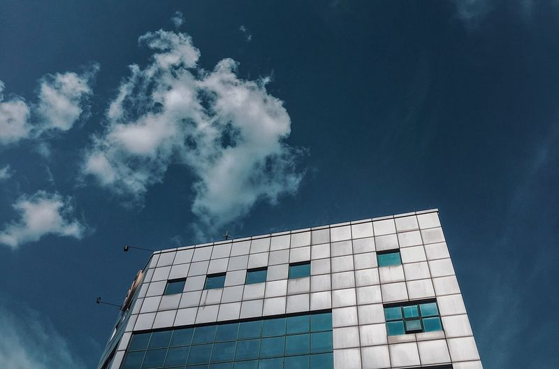 EyeEm Selects Architecture Sky Built Structure Building Exterior Low Angle View Building No People Cloud - Sky Nature Communication Shape Pattern Blue City Modern Outdoors Day Technology