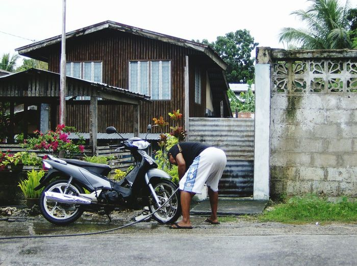 This is Mr. Rudy, a retired policeman. Every morning he wash his motorcycle getting ready strolling for morning excercise. Our place is in Larena Siquijor Philippines. EyeEmNewHere Eye4photography  Outdoors Day Motorcycle Old Man Streetphotography Washing Roadside Adult Urban Photography Luvuhuneko2074 Shiela2074 Siquijorisland Brown Skin Only Men Cool Attitude Philippines ❤️