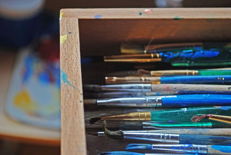 High angle view of paintbrushes in drawer