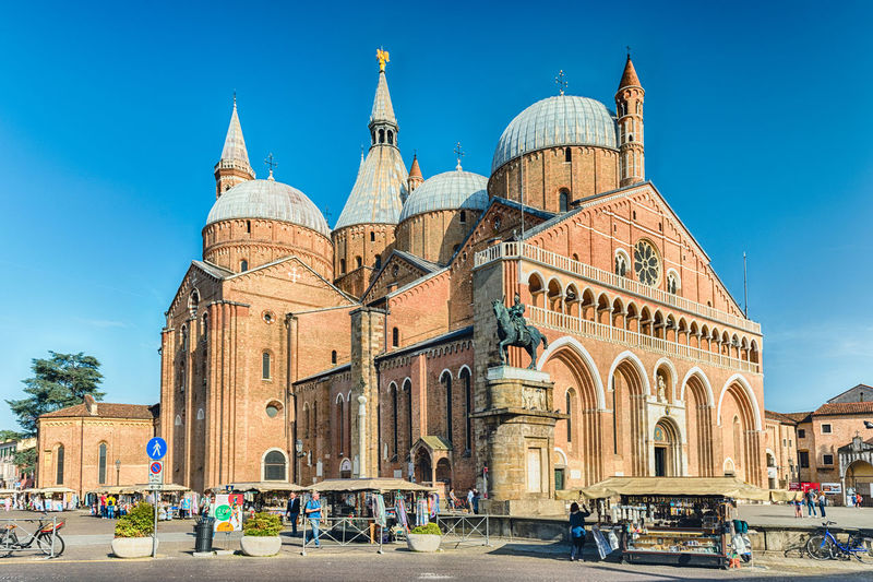 PADUA, ITALY - APRIL 28: Facade of the Basilica of St Anthony, iconic landmark and sightseeing in Padua, Italy, April 28, 2018. It is one of the eight international shrines recognized by the Holy See Arch Architecture Belief Building Building Exterior Built Structure City Crowd Dome Group Of People History Incidental People Large Group Of People Nature Outdoors Religion Sky The Past Tourism Travel Travel Destinations