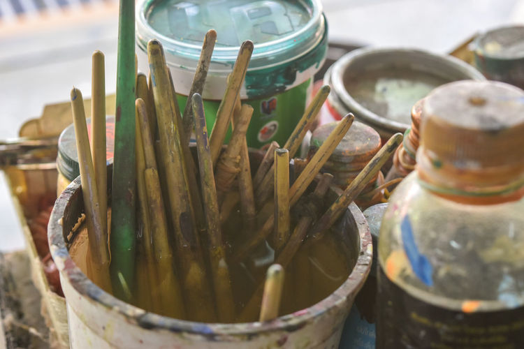 Close-up of paintbrushes in container at workshop