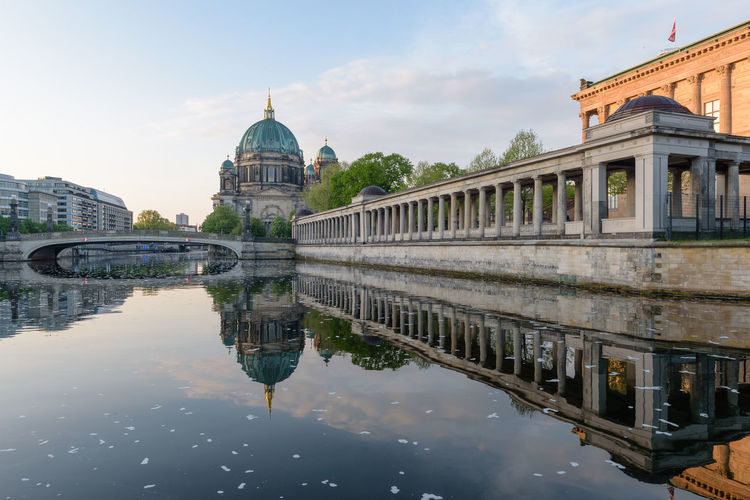 Reflection of berliner dom by spree river against sky