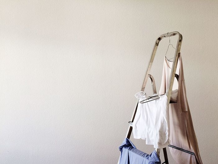 Close-up of clothes hanging on ladder