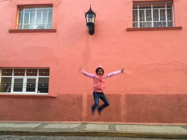 Jumping pink Full Length Building Exterior Standing Outdoors Real People One Person Arms Raised Built Structure Architecture City Children Only Childhood Day People Human Body Part Pink Color Pink Wall Pink Wall ♡♥♡ Latin America Mexico_maravilloso
