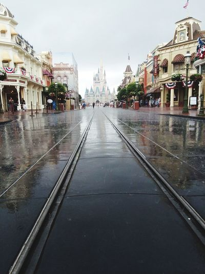 Even in the rain i had to take this shot it and it turned out pretty nice! Disney Rain Street Day Outdoors Water No People City Built Structure Architecture Arrival Travel Destinations Politics And Government Building Exterior Cityscape Sky