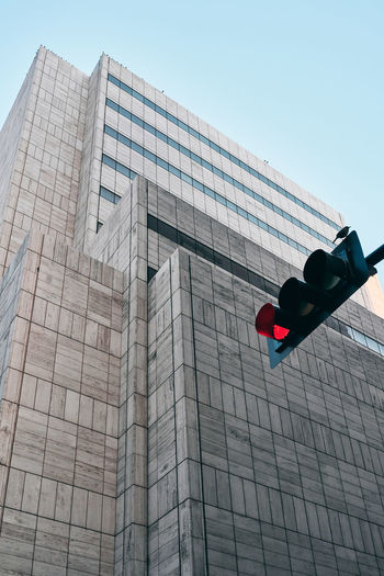 Low angle view of road signal against building