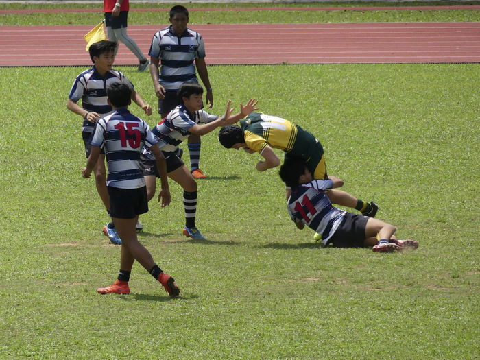 Boys playing on field