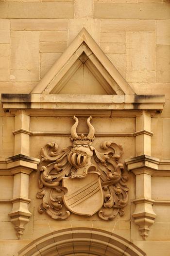 A coat of arms on a art nouveau house Coat Of Arms Art Nouveau Building Crest Entrance Luxury Luxus Noble Coat Noblesse Old Buildings Old Fashioned Rich Sign Symbol