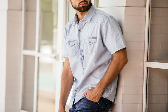 Adult Architecture Beard Casual Clothing Day Facial Hair Front View Fully Unbuttoned Hands In Pockets Jeans Lifestyles Looking Men Midsection One Person Outdoors Standing Three Quarter Length Young Adult