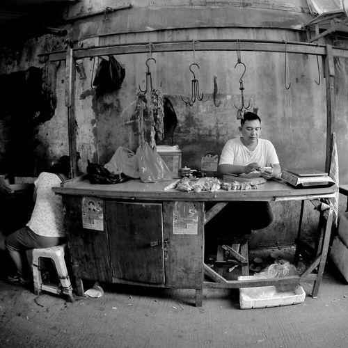 The Butcher, this street portrait is taken at Kawasan Pasar Petak Sembilan. Streetphotography Streetphoto_bw Streetportrait Discoverpetak9 Lumixmakestory Lumixindonesia Lumixgf1