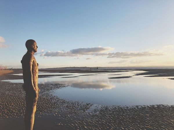 Another Place By Anthony Gormley Another Place Crosby Beach Liverpool Mersey Water Sky One Person Standing Beauty In Nature Sea Reflection
