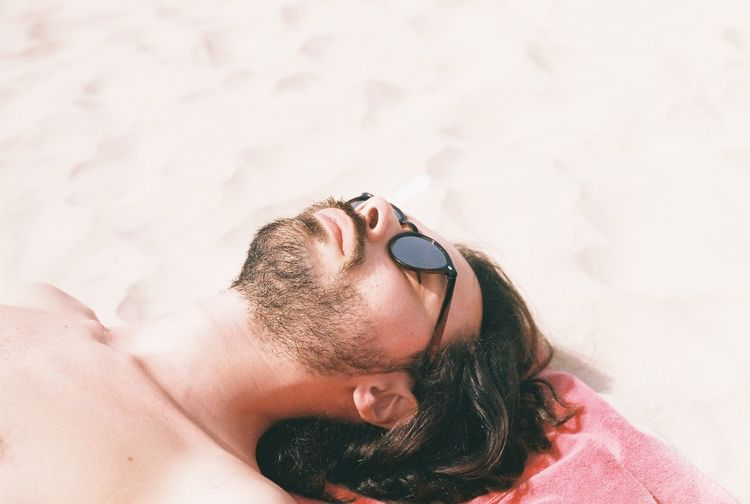 Sunbathing Analogue Photography Beach Life Adult Beach Beard Eyes Closed  Hair Hairstyle Headshot High Angle View Land Laying Down Leisure Activity Lifestyles Lying Down Lying On Back Nature One Person Portrait Real People Relaxation Shirtless Sunbathing Sunglasses Young Adult EyeEmNewHere The Portraitist - 2018 EyeEm Awards