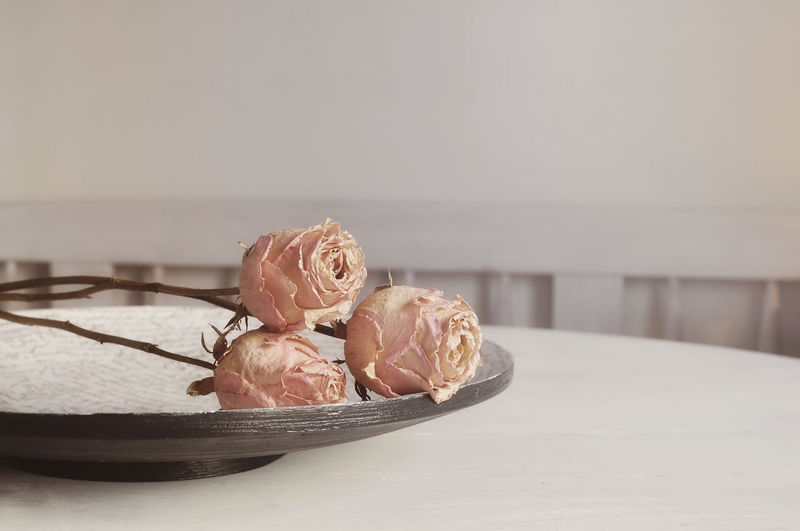 Close-Up Of Roses In Plate On Table