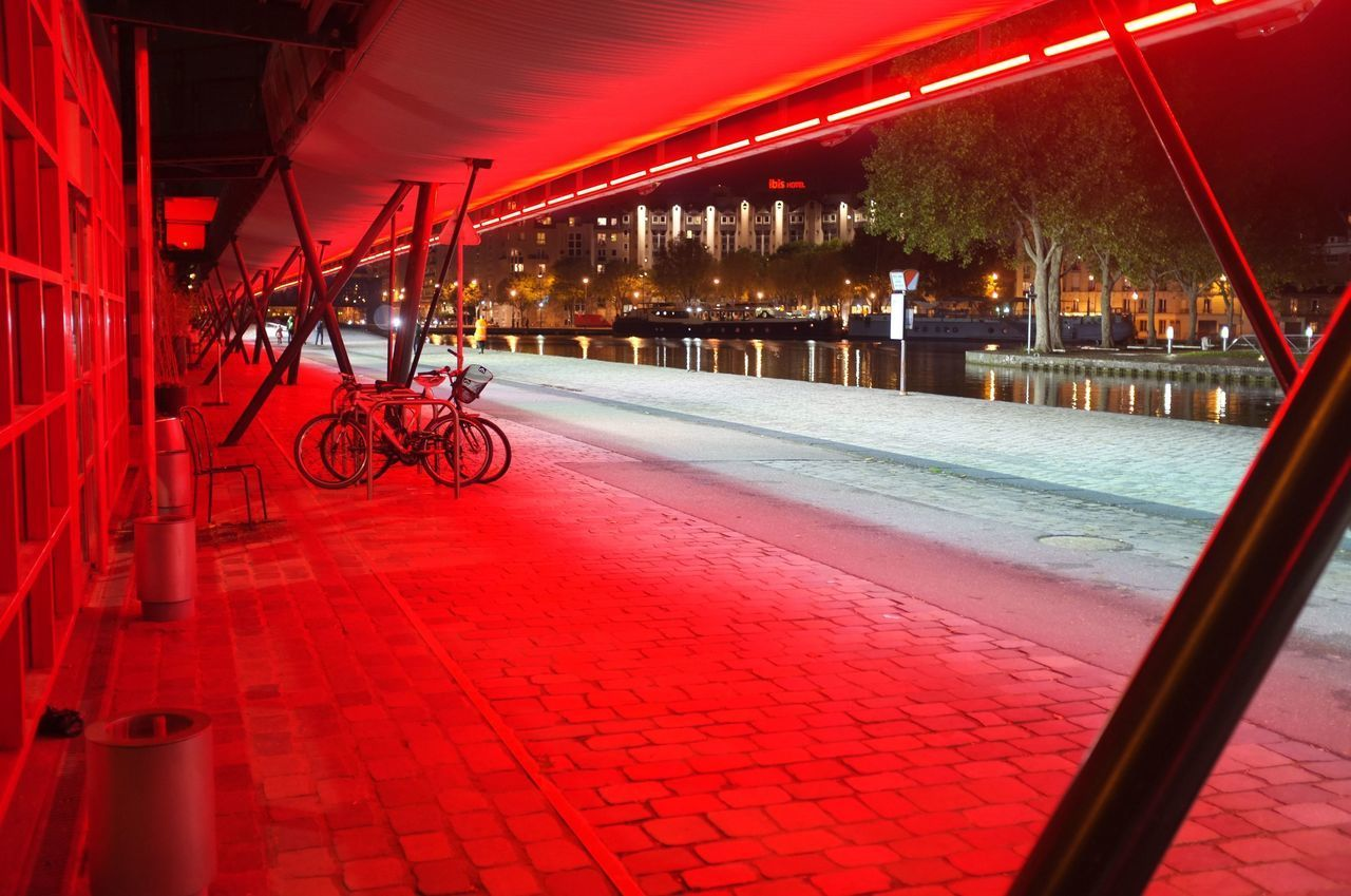 VIEW OF BICYCLE PARKED AT NIGHT