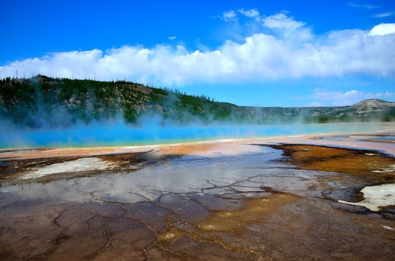 Montana Beauty In Nature Cloud - Sky Day Geyser Hot Spring Lake Landscape Mountain Nature No People Outdoors Physical Geography Scenics Sky Smoke - Physical Structure Steam Tourism Tranquility Travel Travel Destinations Water