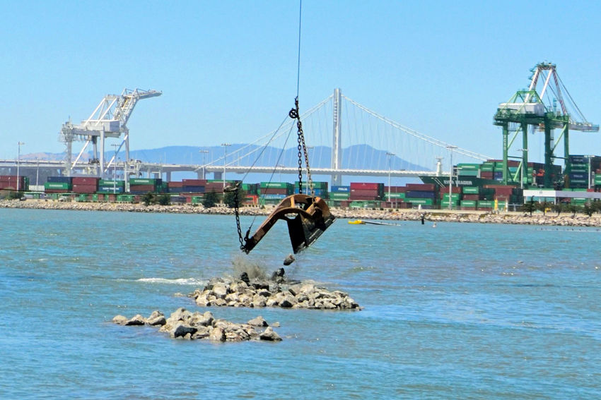 Dredging the Bay 3 Middle Harbor Port Of Oakland, Ca. San Francisco Bay Bay Bridge New Tower Eastern Span Gantry Cranes Port Containers Maritime Waterfront Estuary Dredging Equipment Dumping Rock Rocky Shoreline