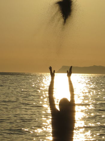 salt of the earth Air Backlight Beauty In Nature Day Ecclectic Enchanted  Enlightened Gravel High Hopes High Spirits Horizon Over Water Human Hand Joyful Men One Person Outdoors People Sea Selfie Silhouette Sky Sunset Throwing  Up In The Air Water