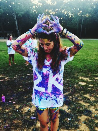 Multi Colored Portrait Fun Adults Only Happiness People Only Women Outdoors Adult One Person Young Adult Day Powder Paint Holi Long Hair Fashion Landscape Teenager Life Model Sorority College Paint War Real People Art
