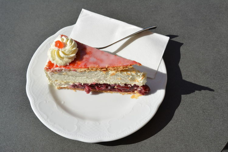 High angle view of baked pastry cake in plate