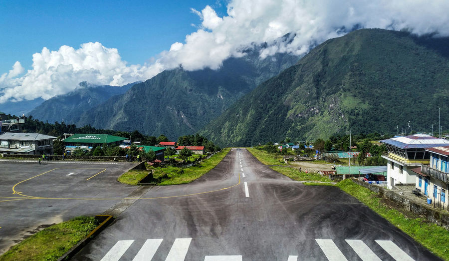 Picture of the Airport Lukla inside the Khumbu Region. Nepal Nepal Travel Lukla Lukla Airport Three Passes Trek Khumbu Himalayas Mountain Mountain Range Cloud - Sky Sky Nature Scenics - Nature Beauty In Nature Mountain Peak Outdoors Travel Destinations Built Structure Transportation Environment Tree Trekking Hiking Travel City