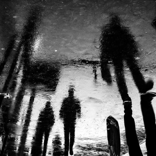 The Street Photographer - 2017 EyeEm Awards Water Lifestyles Shadow Silhouette Real People Outdoors Day People Wet Walking On The Street Ghost Town Ghostly Open Your Heart Open Your Soul Open Your Eyes Zoomthelife Mobilephotography Ground France Beach Men Togetherness Nature Bnw