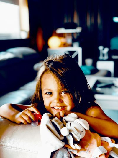 Portrait Of Smiling Girl With Toys At Home