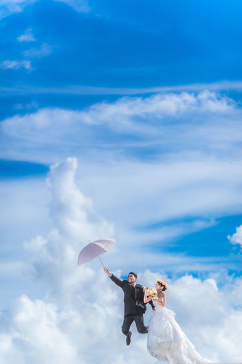 Cloud Cloud - Sky Cloudscape Cloudy D750 Depth Of Field Dramatic Sky Flying Low Angle View Married Mary Poppins Mid-air Nikon Outdoors P Scenics Selective Focus Silhouette Sky Wedding