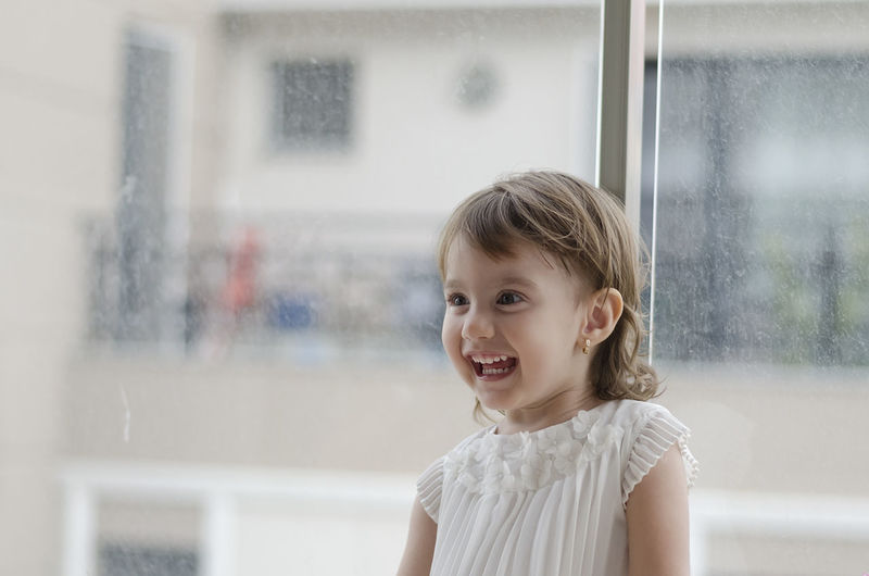 Small angel beauty with sparkling sky in the eyes Childhood Portrait One Person Girls Child Focus On Foreground Females Innocence Outdoors Window Women Headshot Real People Looking Emotion Glass - Material Lifestyles Cute Transparent Hairstyle Mouth Open