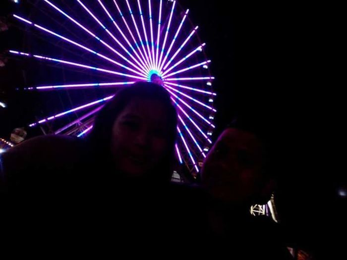 People And Places Christmas is in the air. Spending time with this cool person beside me in the cold city of Tagaytay. BigParol Ferris Wheel Ferris Wheel At Night Hneriah's Joyney Fiance Love Lights Light And Shadow Circles Declare Claim Believe Thanks Yesh Ber Month